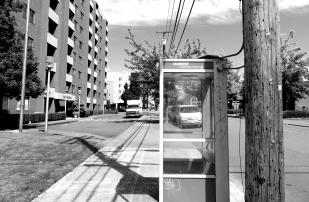this phone booth was once hi-tech but is now bypassed by technology