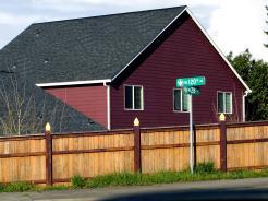 house, fence, and signage