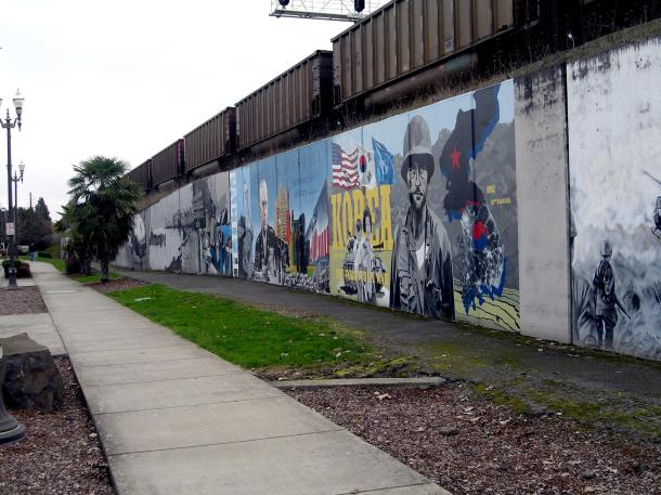 along some corridors in vancouver rails run atop berms preventing easy access to the columbia river, civic minded individuals created a wall that stretches 550 feet along one such berm commemorating ww1 and 2, korea, and vietnam.