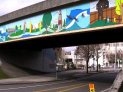 vancouver is moving eastward away from its roots like so many towns and cities nation wide and like so many towns and cities nationwide the core downtown area is revitalizing adding splashes of color reflecting said downtown on railroad spans.