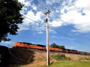 a coal train waiting it's trip into the yard for whatever it is that needs to be accomplished.