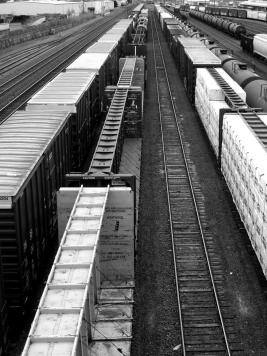 since my early days trains facinate whether frieght, diesel, steam, passenger or as here awaiting assembly to ship or pickup products that keep industries sparking the economy.