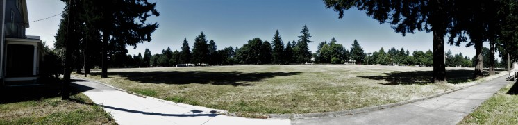 horses galloped, soldiers paraded and practiced aim, generals entertained, soldiers trained for two world wars. the vancouver barracks parade ground, officers row in the distance.